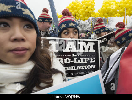 Pro-life activists take part in a rally before the March for Life in Washington, DC on January 22, 2016. Activists from across the nation participated in the annual pro-life rally protesting abortion and the 1973 Roe v. Wade Supreme Court decision legalizing abortion.  Photo by Molly Riley/UPI - Stock Photo