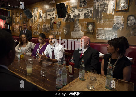 President Barack Obama speaks to the media after having lunch with formerly incarcerated individuals who have received commutations, at Bus Boys and Poets restaurant in Washington, D.C. on March 30, 2016. Obama commented 61 additional sentences today. Photo by Kevin Dietsch/UPI - Stock Photo