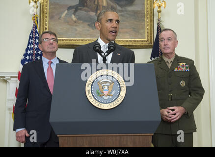 President Barack Obama, joined by Defense Secretary Ash Carter (L) and Chairman of the Joint Chiefs of Staff Marine Gen. Joseph Dunford, announces that the United States will leave more troops in Afghanistan than originally planned through the end of the year, in the Roosevelt Room at the White House in Washington, D.C. on July 6, 2016. Obama announced a draw down of troops to 8,400 by the end of his administration. Photo by Kevin Dietsch/UPI - Stock Photo