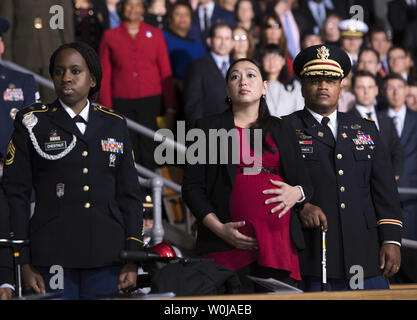 Audience members watch the Armed Forces Full Honor Review Farewell Ceremony for President Obama at Joint Base Myers-Henderson Hall, in Virginia on January 4, 2017. The five braces of the military honored the president and vice-president for their service as they conclude their final term in office. Photo by Kevin Dietsch/UPI - Stock Photo