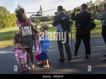 The D'Amico family watches as Marine One, carrying President Donald Trump, lands on the South Lawn of the White House, in Washington, D.C. on April 18, 2017. Trump was returning from a day trip to Wisconsin where he visited Snap-on tools. Photo by Kevin Dietsch/UPI - Stock Photo