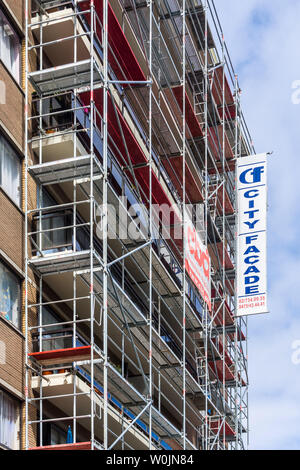 Scaffolding on apartment block for renovations - Brussels, Belgium. - Stock Photo
