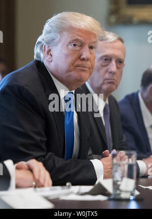 President Donald Trump speaks alongside Defense Secretary Jim Mattis as he addresses the press during a Cabinet meeting at the White House on December 6, 2017 in Washington, D.C. Photo by Kevin Dietsch/UPI - Stock Photo