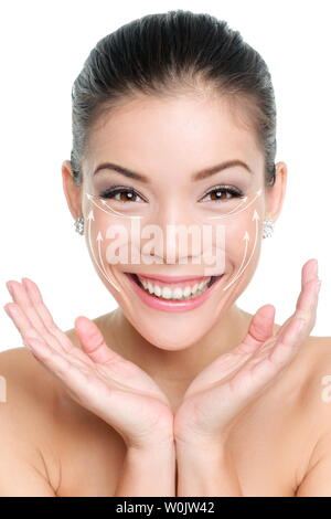 Face lift anti-aging treatment. Lifting effects of cream lotion or treatment on Asian woman smiling very happy with results. Graphic lines showing facial lifting effect on skin. - Stock Photo