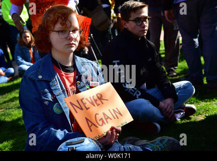 Local area students hold a gun protest sit-in near the White