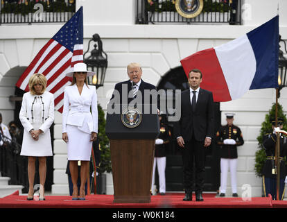 President Donald Trump makes remarks as he welcomes French President Emmanuel Macron (R) along with First Lady Melania Trump (2nd,L) and Macron's wife Brigitte to the White House for a State Visit, April 24, 2018, in Washington, DC. The leaders are expected to discuss trade, Iran, climate change, North Korea, Russia among other issues.     Photo by Mike Theiler/UPI - Stock Photo