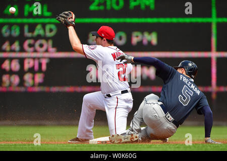 Atlanta Braves first baseman Freddie Freeman (5) slides safely into second against Washington Nationals second baseman Daniel Murphy (20) in the third inning at Nationals Park in Washington, D.C. on August 9, 2018. Photo by Kevin Dietsch/UPI - Stock Photo