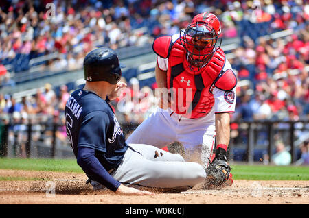 Washington Nationals catcher Matt Weiters (32) tags out Atlanta Braves first baseman Freddie Freeman (5) as he attempts to slides home in the third inning at Nationals Park in Washington, D.C. on August 9, 2018. Photo by Kevin Dietsch/UPI - Stock Photo