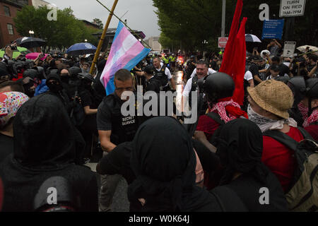 Counterprotesters clash with United States Secret Service agents near the Unite the Right 2 rally near the White House in Washington, D.C. on August 12, 2018. Groups of White supremacists, neo-nazis, the alt-right, antifa and their counterprotesters are marching in the nation's capital on the one-year anniversary of a white nationalist rally in Charlottesville, Virginia, that left one woman dead and dozens injured.   Photo by Alex Edelman/UPI - Stock Photo