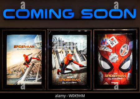 Bangkok, Thailand - Jun 26, 2019: Spider-Man: Far From Home movie poster with coming soon display showing in theatre. Cinema promotional advertisement - Stock Photo