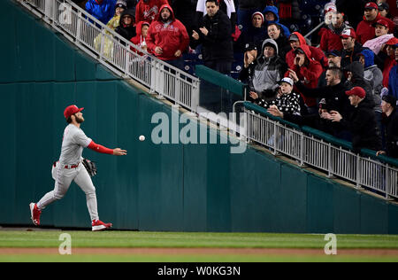 Philadelphia Phillies right fielder Bryce Harper tosses a ball to the fans in the fourth inning against the Washington Nationals at Nationals Park on April 2, 2019 in Washington, D.C. This is Harper's first time returning to Nationals Park since leaving for the Phillies. Photo by Kevin Dietsch/UPI - Stock Photo
