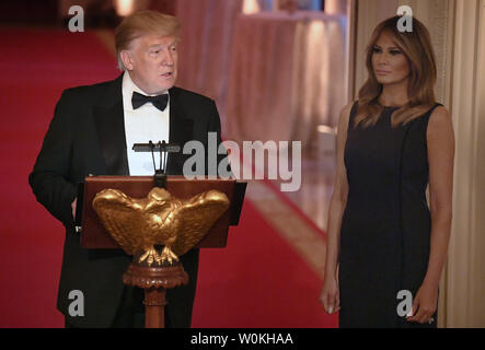 President Donald Trump (L) makes remarks as First Lady Melania Trump listens as they host a White House Historical Association dinner at the White House, May 15, 2019, in Washington, DC. The organization's goal is to promote the public's understanding, appreciation and enjoyment of the White House.    Photo by Mike Theiler/UPI - Stock Photo