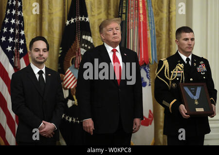 U.S. President Donald Trump presents the Medal of Honor posthumously to Army Staff Sergeant Travis Atkins for conspicuous gallantry during an event at the White House in Washington on March 27, 2019. Photo by Yuri Gripas/UPI - Stock Photo