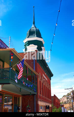 The Pythian Castle secret society lodge building clock tower in historic Bisbee AZ. Once a secret society lodge, now newly restored into apartments - Stock Photo