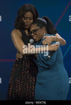 First lady Michelle Obama hugs Oprah Winfrey after they spoke at the White House United State of Women Summit in Washington, D.C. on June 14, 2016.   Photo by Molly Riley/UPI - Stock Photo