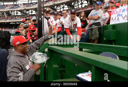 Washington Nationals manager Dusty Baker accepts matzah ball soup from baseball fans for good luck in game 1 of the National League Division Series against the Los Angeles Dodgers at Nationals Park in Washington, D.C., October 7, 2016. Photo by Pat Benic/UPI - Stock Photo