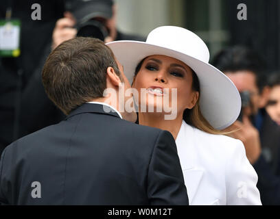French President Emmanuel Macron greets U.S. first lady Melania Trump during official welcoming  ceremony for the State Visit on the South Lawn of the White House on Tuesday, April 24, 2018.   Photo by Pat Benic/UPI - Stock Photo