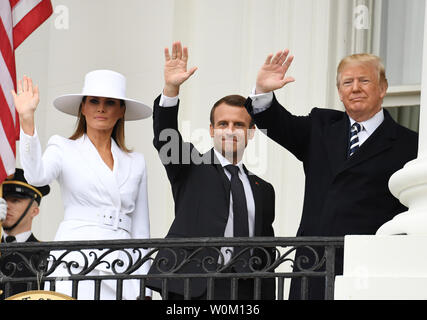 U.S. President Donald Trump, first lady Melania Trump, French President Emmanuel Macron and Brigitte Macron wave from the balcony during official welcoming ceremony for the French State Visit at the White House on Tuesday, April 24, 2018.   Photo by Pat Benic/UPI - Stock Photo
