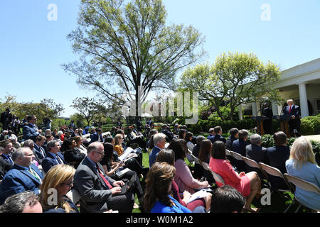 A reporter asks a question U.S. President Donald Trump listens with Nigerian President Muhammadu Buhari in the Rose Garden during a joint press conference at the White House on April 30, 2018 in Washington, DC.    Buhari is on a one-day visit to the White House.  Photo by Pat Benic/UPI - Stock Photo
