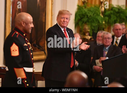 President Donald Trump applauds Medal of Honor  recipient retired Sgt. Maj. John Canley in the East Room of the White House in Washington, DC on October 17, 2018. The 80-year-old former Marine who lives in Oxnard, California, received the award for service in the battle of Hue 50 years ago.   Photo by Pat Benic/UPI.