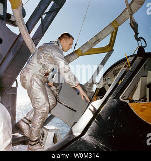 NASA astronaut Neil Armstrong, prime crew Command pilot on Gemini 8, climbs into a full-scale model of the Gemini spacecraft during water egress training on the Gulf of Mexico in January 15, 1966. March 16, 2016 marks the 50th anniversary of NASA's Gemini 8 mission, the sixth manned spaceflight conducted during the United States' Project Gemini program. The primary objective of the mission, the successful docking of two spacecraft in orbit, a first in spaceflight, was a success though the crew would experience a critical in-space system failure, forcing them to abandon the mission prematurely. - Stock Photo