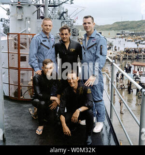 The Gemini 8 crew stands on the deck of the recovery vessel, the USS Leonard F. Mason, with three U.S. Air Force Pararescuemen, on March 17, 1966. From left to right (standing) are astronaut Neil Armstrong, command pilot; A2C Glenn Moore; astronaut David Scott, pilot; kneeling, left to right are A1C Eldridge Neal; and SSG Larry Huyett. March 16, 2016 marks the 50th anniversary of NASA's Gemini 8 mission, the sixth manned spaceflight conducted during the United States' Project Gemini program. The primary objective of the mission, the successful docking of two spacecraft in orbit, a first in spa - Stock Photo