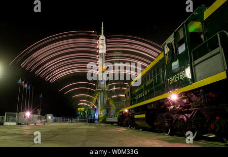 The gantry arms close around the Soyuz TMA-20M spacecraft to secure the rocket, as seen in this long exposure photograph taken on March 16, 2016, at Launch Pad 1 at the Baikonur Cosmodrome in Kazakhstan. Launch of the Soyuz rocket is scheduled for March 19, and will carry Expedition 47 Soyuz Commander Alexey Ovchinin of Roscosmos, Flight Engineer Jeff Williams of NASA, and Flight Engineer Oleg Skripochka of Roscosmos into orbit to begin their five and a half month mission on the International Space Station. NASA Photo by Aubrey Gemignani/UPI - Stock Photo