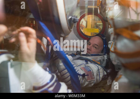 In the Integration Facility at the Baikonur Cosmodrome in Kazakhstan, Expedition 47 crew member Jeff Williams of NASA is seen in his seat through a window on the Soyuz TMA-20M spacecraft on March 4, 2016, as he and his crewmates conducted a Òfit checkÓ dress rehearsal during pre-launch training. Williams and Alexey Ovchinin and Oleg Skripochka of Roscosmos will launch on March 19, Kazakh time, for a six-month mission on the International Space Station. NASA Photo by GCTC/UPI - Stock Photo