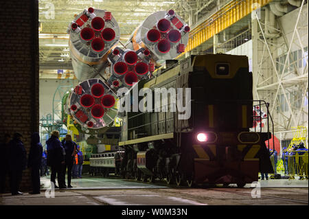 The Soyuz TMA-20M spacecraft is rolled out to the launch pad by train in the early hours of March 16, 2016, at the Baikonur Cosmodrome in Kazakhstan. Launch of the Soyuz rocket is scheduled for March 19, and will carry Expedition 47 Soyuz Commander Alexey Ovchinin of Roscosmos, Flight Engineer Jeff Williams of NASA, and Flight Engineer Oleg Skripochka of Roscosmos into orbit to begin their five and a half month mission on the International Space Station. NASA Photo by Aubrey Gemignani/UPI - Stock Photo