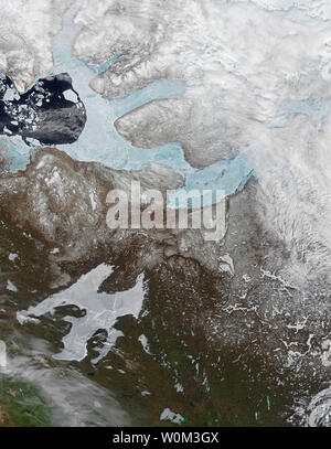 On May 29, 2017, the Moderate Resolution Imaging Spectroradiometer (MODIS) on NASA's Terra satellite captured this image of ice covering the Amundsen Gulf, Great Bear Lake, and numerous small lakes in the northern reaches of Canada's Northwest Territories and Nunavut. Sea ice generally forms in the Gulf of Amundsen in December or January and breaks up in June or July. Lake and river ice in this area follow roughly the same pattern, though shallow lakes freeze up earlier in the fall and melt earlier in the spring than larger, deeper lakes. NASA/UPI - Stock Photo