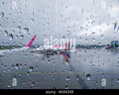 Warsaw, Poland - May 16, 2019: Rain at the airport, the view from the window of the plane. Warsaw, Poland - Stock Photo