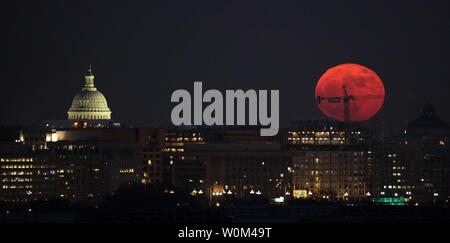 The Moon is seen as is rises on December 3, 2017, in Washington, D.C. Today's full Moon is the first of three consecutive supermoons. The two will occur on January 1 and January 31, 2018. A supermoon occurs when the moon's orbit is closest (perigee) to Earth at the same time it is full. NASA Photo by Bill Ingalls/UPI - Stock Photo