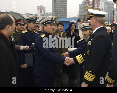 Rear Adm. Xu Jiwen, commander of Shanghai Naval Base (L) greets Vice Adm. Robert Willard, Commander U.S. Seventh Fleet, shortly after the Seventh Fleet command ship USS Blue Ridge arrived in Shanghai on a regularly scheduled port visit February 24, 2004.  Blue Ridge last visited the port city in March 2001.  Shanghai is China's largest city with more than 13 million in polulation.   (UPI Photo/Michael R. McCormick/US Navy) - Stock Photo