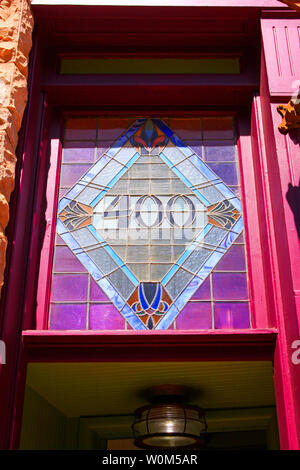 Stained glass window over the entrance to Brownstone Suites hotel on Brewery Ave in historic Bisbee, AZ - Stock Photo