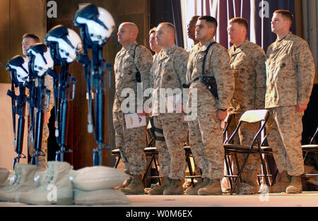 Marines from Marine Heavy Helicopter Squadron 361 stand at attention Feb. 2, 2005 at the start of an emotional memorial service for the four-man crew that lost their lives in a helicopter crash in the Al Anbar Province of Iraq Jan. 26, 2005.   (UPI Photo/Chad McMeen/USMC) Stock Photo