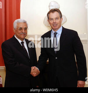 Palestinian President Mahmoud Abbas (L) shakes hands with Britain's Prime Minister Tony Blair at 10 Downing Street in London on February 28, 2005.   (UPI Photo/Omar Rashidi/Palestinian Authority) - Stock Photo