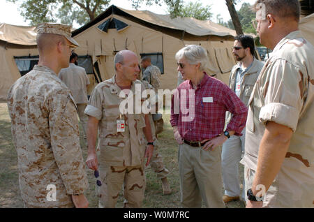 U.S. Ambassador to Pakistan, Ryan C. Crocker (center right), meets with U.S. Navy Rear Adm. Michael A. Lefever (center left), at the Pakistan Air Force base in Chaklala Pakistan, to discuss the progress of earthquake relief efforts on October 15, 2005.  Rear Adm. Lefever, commander of Expeditionary Strike Group (ESG) 1, has been designated as coordinator, Disaster Assistance Center, Pakistan. The United States government is participating in a multinational humanitarian assistance and support effort lead by the Pakistani Government to bring aid to victims of the devastating earthquake that stru - Stock Photo