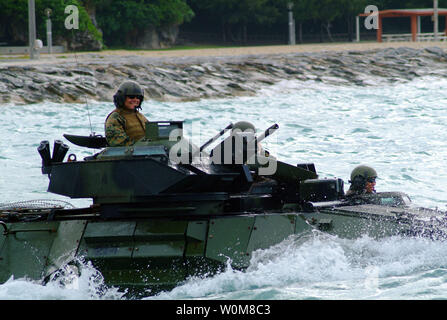 U.S. Marines in an amphibious assault vehicle from the 31st Marine Expeditionary Unit approaches the well deck of the USS Harpers Ferry, off the coast of White Beach, Okinawa, Japan on March 22, 2006. (UPI Photo/Brian P. Biller/USNV) - Stock Photo