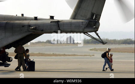 U.S. citizens exit a U.S. Marine Corps CH-53 Super Stallion helicopter at Royal Air Force Base Akrotiri in Cyprus following their flight from the U.S. Embassy in Beirut, Lebanon, on July 17, 2006.  At the direction of the U.S. Ambassador to Lebanon and the U.S. Secretary of Defense the 24th Marine Expeditionary Unit is assisting with the evacuation of U.S. citizens from Lebanon. (UPI Photo/Petty Officer 1st Class Michael B.W. Watkins/U.S. Navy)