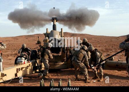 U.S. Marines from 3rd Battalion, 12th Marine Regiment fire a 120mm artillery round from a M198 Howitzer in western Al Anbar Province, Iraq on December 21, 2006. (UPI Photo/ Michael Q. Retana/U.S. Marines) - Stock Photo