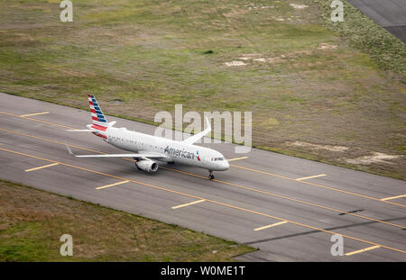 NEW YORK, UNITED STATES OF AMERICA-JUNE 17, 2019: An American Airlines commuter jet moves across the tarmac of JFK International Airport in New York i - Stock Photo