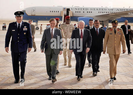 U.S. Defense Secretary Robert M. Gates walks with U.S. Air Force Maj. Gen. Paul 'Dutch' Van Sickle and other Saudi officials during his arrival into Riyadh, Saudi Arabia, May 5, 2009. Secretary Gates is in Saudi Arabia to meet with local leaders and discuss defense issues. (UPI Photo/Jerry Morrison/DOD) - Stock Photo