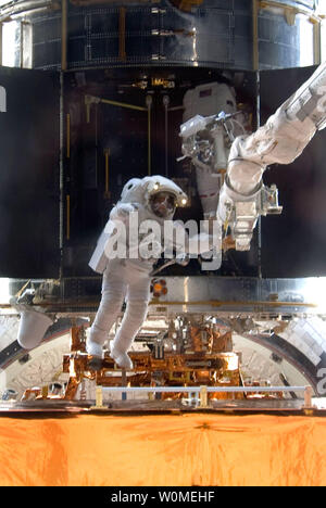 This NASA photo shows astronaut John Grunsfeld, STS-125 mission specialist, as he participates in the mission's third session of extravehicular activity (EVA) as work continues to refurbish and upgrade the Hubble Space Telescope, May 16, 2009 During the six-hour, 36-minute spacewalk, Grunsfeld and astronaut Andrew Feustel (out of frame), mission specialist, removed the Corrective Optics Space Telescope Axial Replacement and installed in its place the new Cosmic Origins Spectrograph. They also completed the Advanced Camera for Surveys electronic card replacement work, and completed part 2 of th - Stock Photo