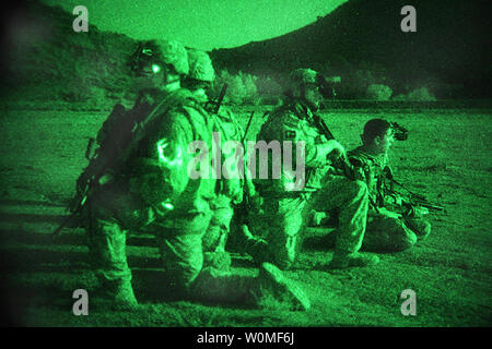 Army Pathfinders, assigned to the 3rd Battalion, 101st Aviation Brigade, and Soldiers from the 2nd Battalion, 377th Parachute Field Artillery Regiment, 4th Brigade Combat Team, 25th Infantry Division, pull security during an air-assault mission to search Khost province, Afghanistan, as part of Operation Champion Sword, August 4, 2009. Afghan National Security Forces and International Security Assistance Forces teamed up for the joint operation, targeting specific militants in eastern Afghanistan. UPI/Matthew Freire/US Army - Stock Photo