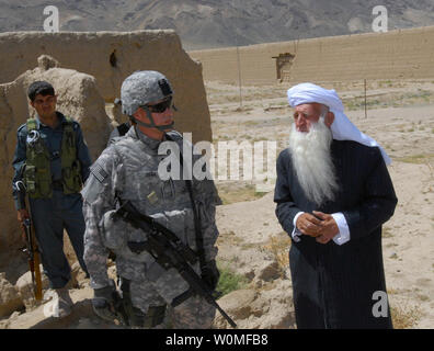U.S. Army Lt. Col. James Zieba (L), a staff judge advocate with Task Force Cyclone, and Abdul Manan Atazada, the chief judge of the Kapisa province of Afghanistan, discuss building plans for a jail in the Tagab Valley district center area of the province on August 25, 2009.  The task force's mission is to assist the Afghan government with security, construction, economic and agricultural support as well as to facilitate the reception, training, housing and sustainment of U.S. troops entering the country. UPI/William E. Henry/U.S. Army - Stock Photo