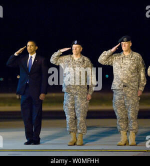 President Barack Obama, Army Maj. Gen. Daniel V. Wright, and Army Brig. Gen. Michael S. Repass render honors during as a team of Soldiers carry the remains of Sgt. Dale R. Griffin during a dignified transfer ceremony at Dover Air Force Base, Delaware on October 29, 2009. Griffin, who was assigned to 1st Battalion, 17th Infantry Regiment, 5th Stryker Brigade Combat Team, 2nd Infantry Division, was killed in action on October 27, 2009, by a roadside bomb in the Kandahar province of Afghanistan. UPI/Jason Minto/U.S. Air Force - Stock Photo