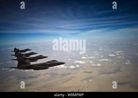 U.S. Air Force F-22 Raptors fly in formation during a training mission on December 9, 2009 over Southwest Asia.  The F-22 fighters and crews are deployed from the 27th Fighter Squadron at Langley Air Force Base, Virginia. UPI/Michael B. Keller/U.S. Air Force - Stock Photo