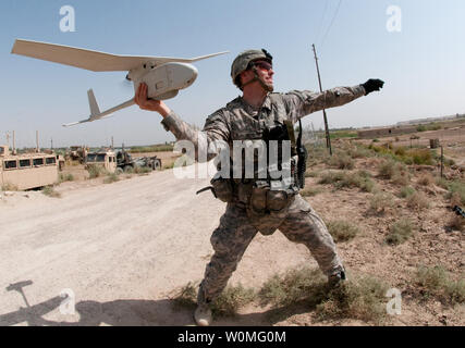 Army 1st Lt. Steven Rose launches an RQ-11 Raven unmanned aerial vehicle near a new highway bridge project along the Euphrates River north of Taqqadum, Iraq on October 9, 2009. UPI/Michael J. MacLeod/U.S. Army - Stock Photo