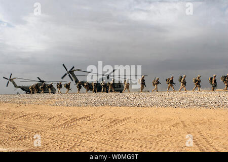 U.S. Marines conduct on and off drills on CH-53D 'Super Stallion' helicopters in Camp Dwyer, Helmand province, Afghanistan on January 23, 2010.  UPI/Samuel A. Nasso/U.S. Marine Corps Stock Photo