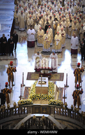 Pope Benedict XVI kneels before the coffin of his predecessor Pope John Paul II in St. Peter's Basilica in the Vatican following his beatification on May 1, 2011.   UPI/Stefano Spaziani - Stock Photo